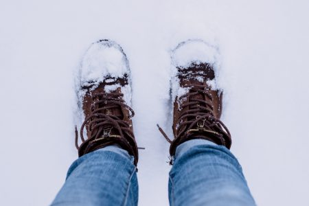Snow covered shoes - free stock photo