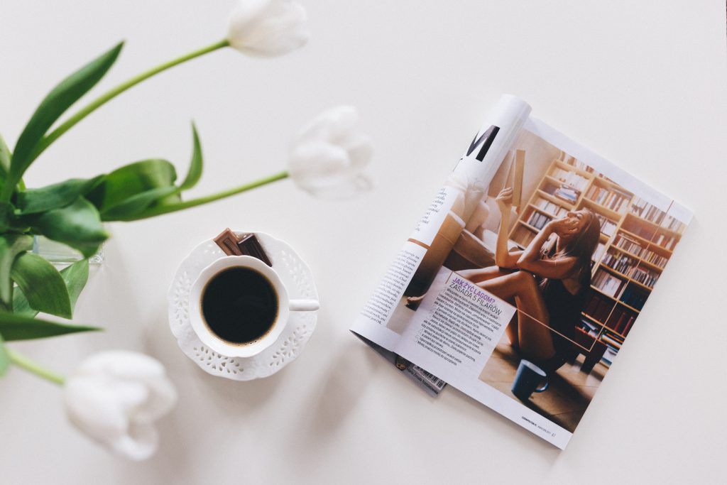 Tulips, cup of coffee and a magazine - free stock photo