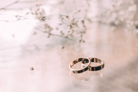 Wedding rings on a glass table - free stock photo