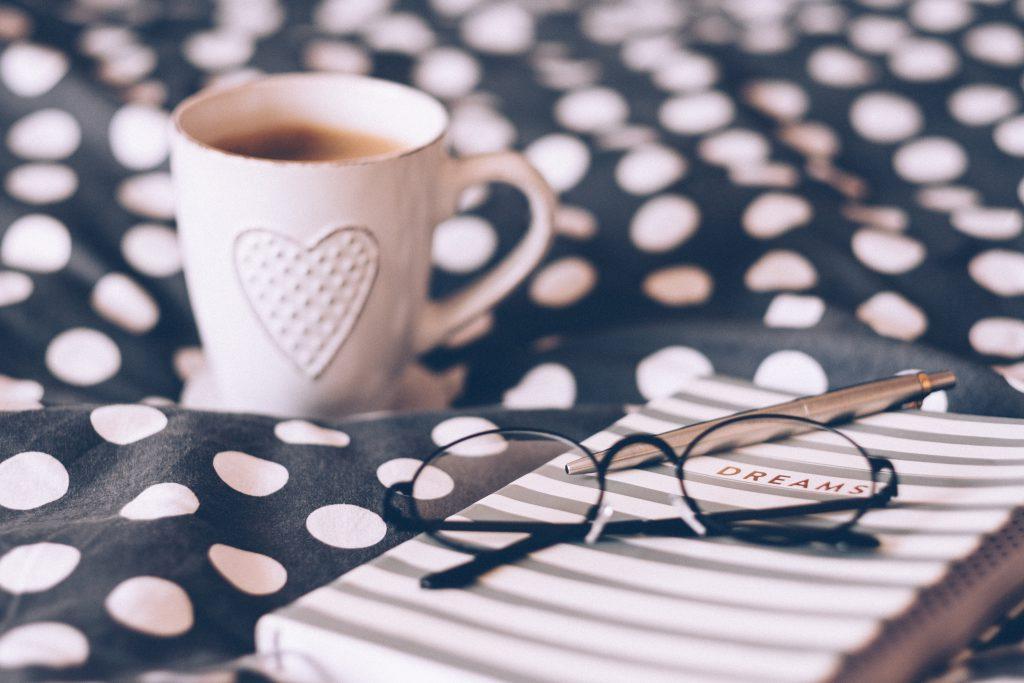 Coffee mug, notebook and glasses - free stock photo