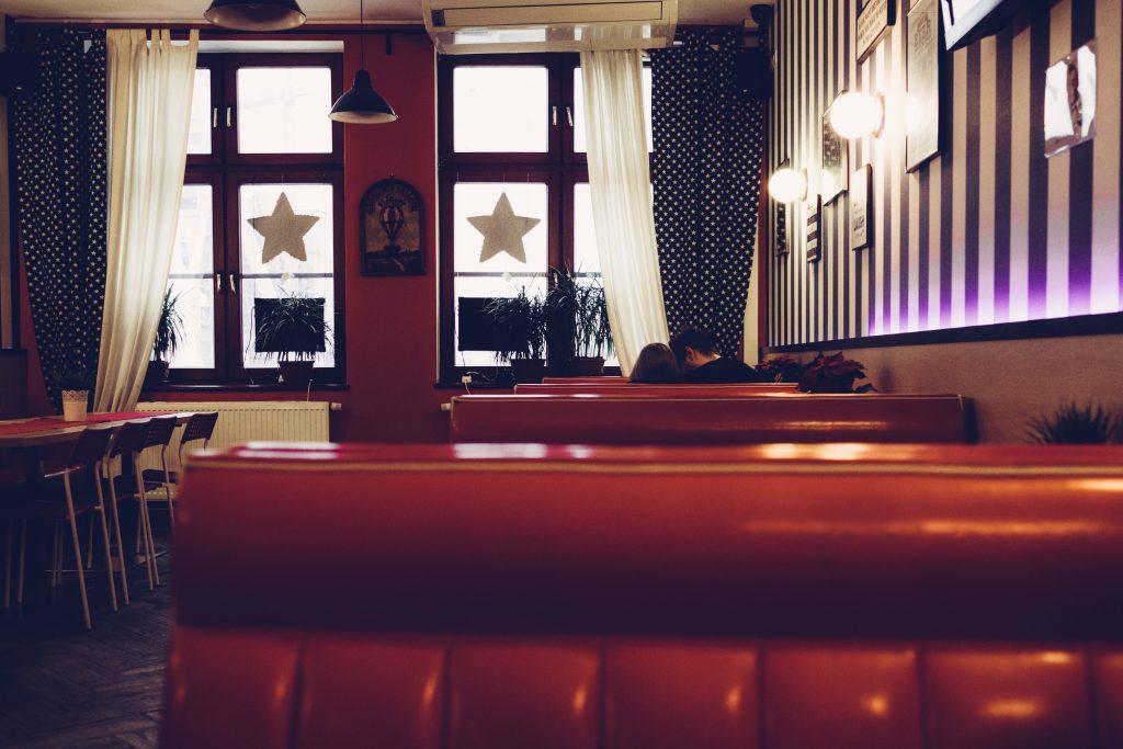 A couple in a retro café - free stock photo