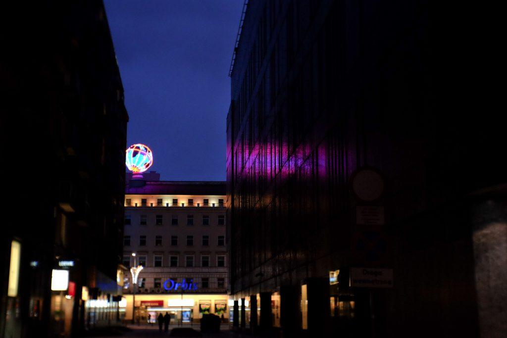 Illuminated led globe in the city at night - free stock photo