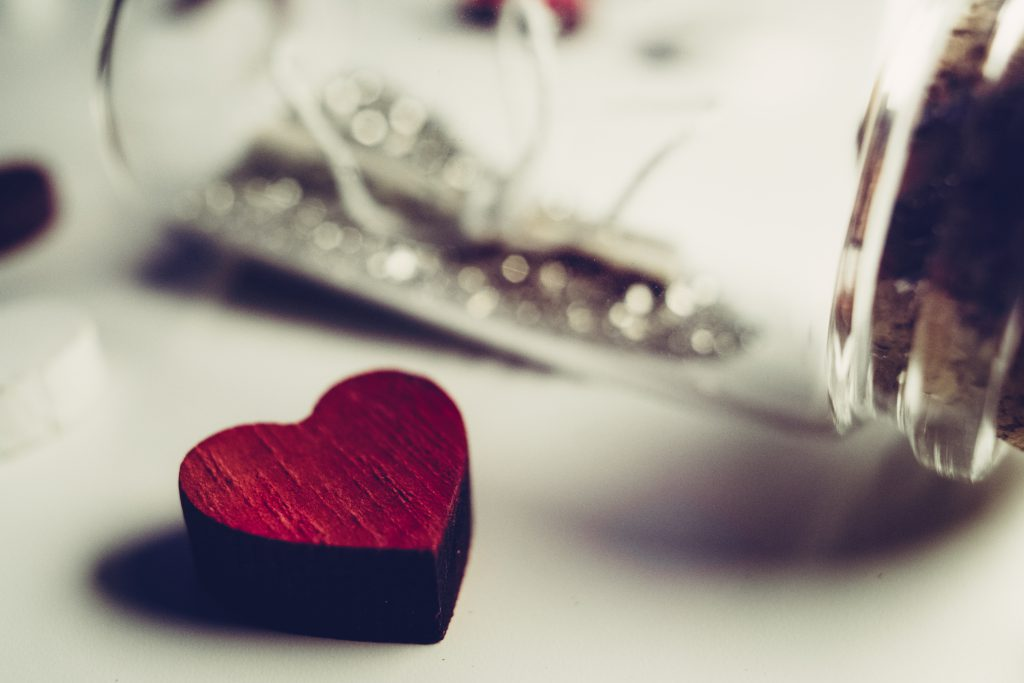 Message in a bottle and a wooden heart - free stock photo