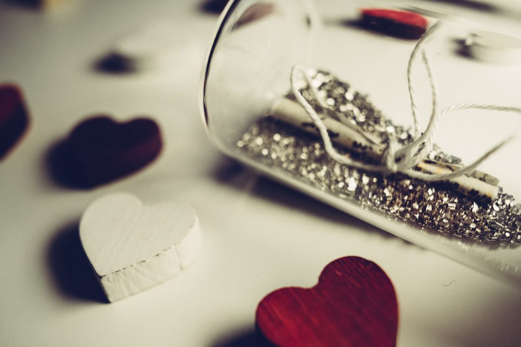 Message in a bottle and wooden hearts - free stock photo