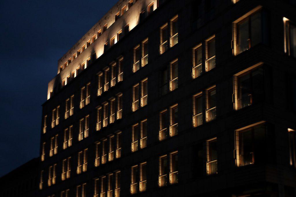 Modern building windows at night - free stock photo