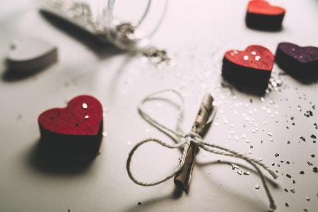 Tiny letter and wooden hearts - free stock photo