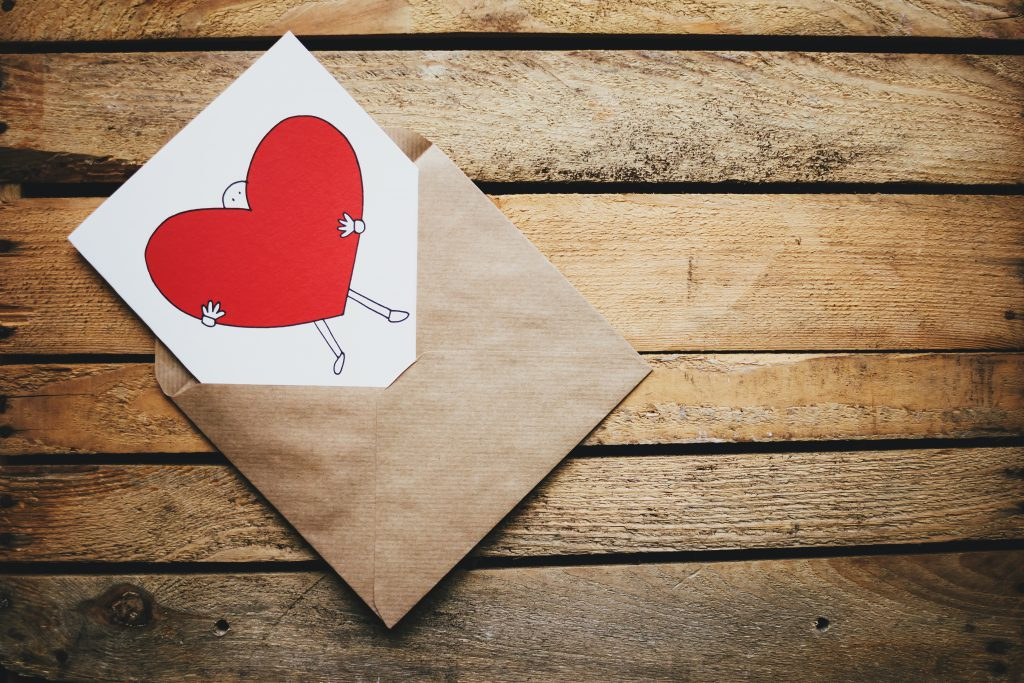 Valentines card on a wooden box - free stock photo