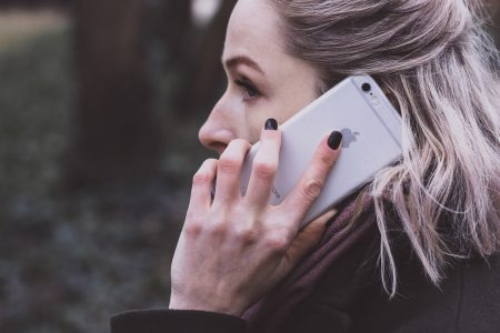 A woman talking on the phone closeup - free stock photo