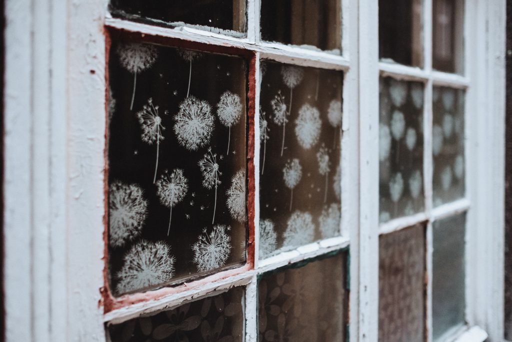 Old wooden window with spray ornaments - free stock photo