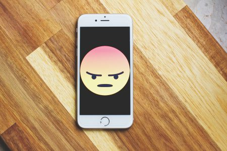 Angry face emoticon on iPhone - free stock photo