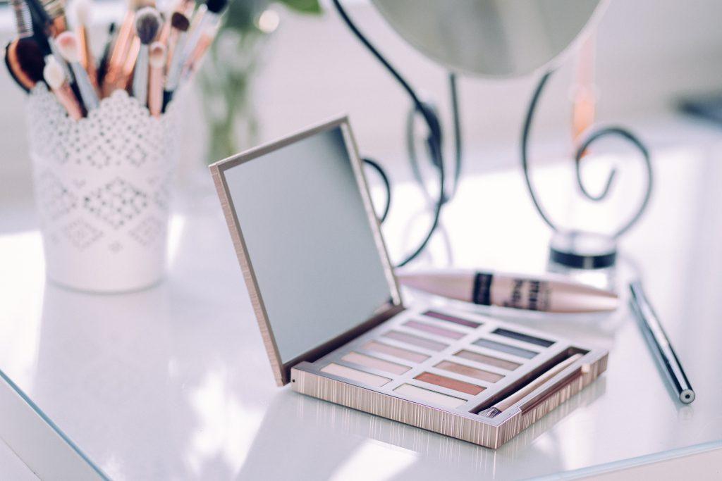 Eyeshadows and makeup brushes - free stock photo
