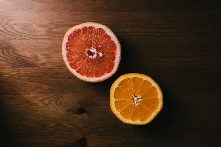 Grapefruit and orange cut in half - free stock photo