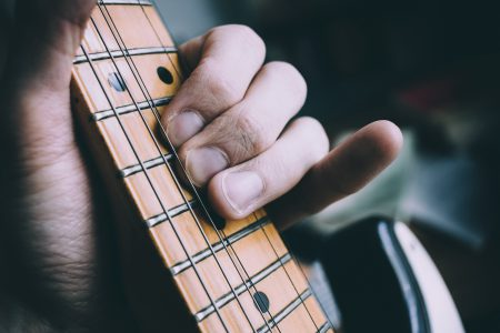 Guitarist hand playing guitar - free stock photo