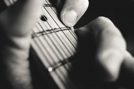 Guitarist hand playing guitar closeup - free stock photo