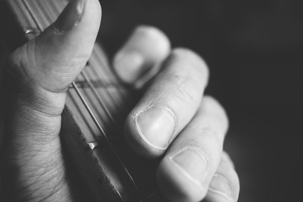 Guitarist hand playing guitar closeup 2 - free stock photo