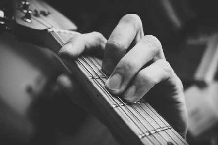 Guitarist hand playing guitar in black and white 2 - free stock photo