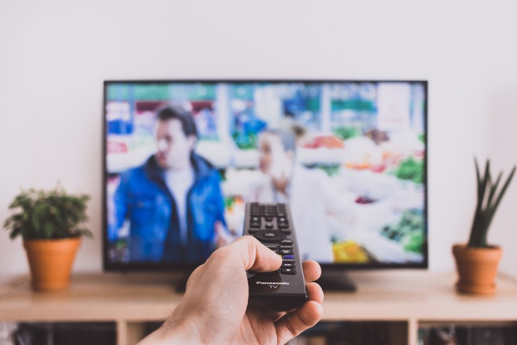 Remote control pointed at a TV screen