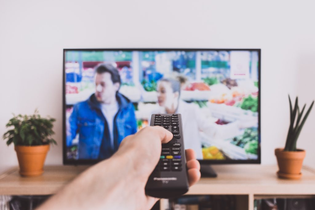 Remote control pointed at a TV screen 2 - free stock photo