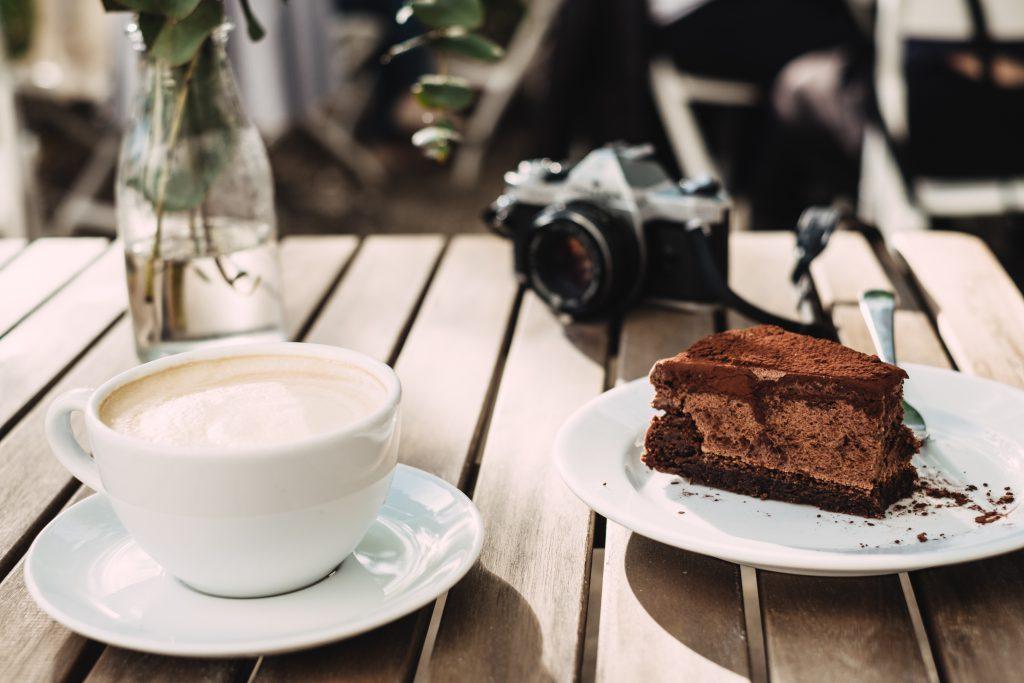 Coffee, chocolate cake and an analog camera - free stock photo