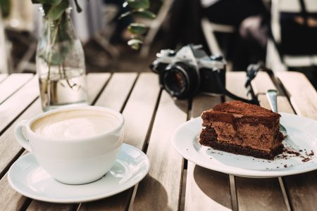 Coffee, chocolate cake and an analog camera - free stock photo