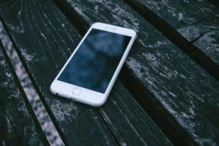iPhone on a wooden bench - free stock photo