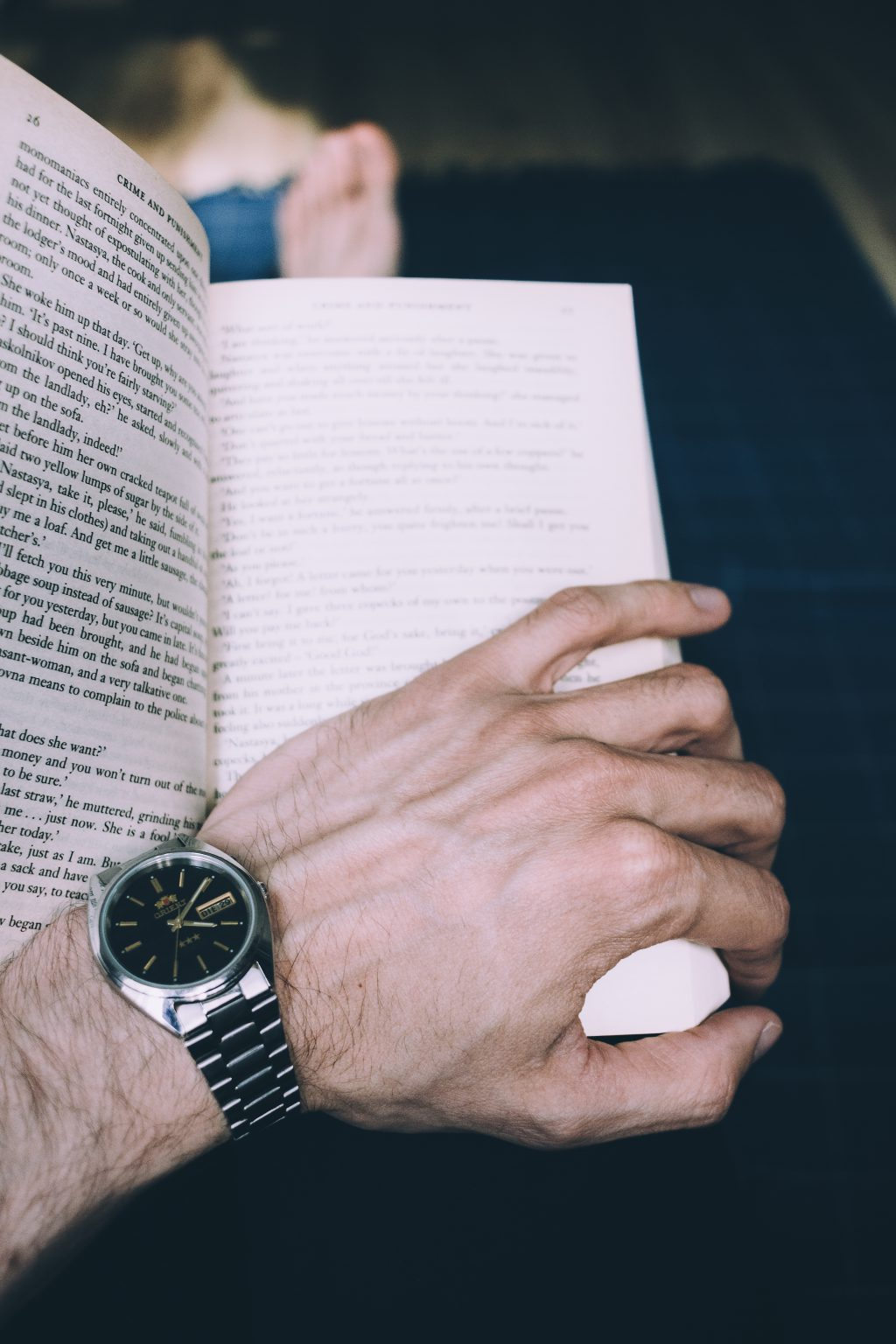 Male hand holding an open book 2 - free stock photo