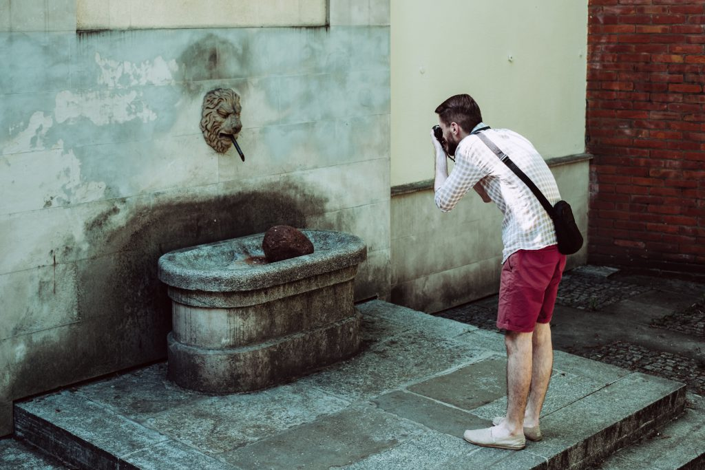 Male tourist taking a picture - free stock photo