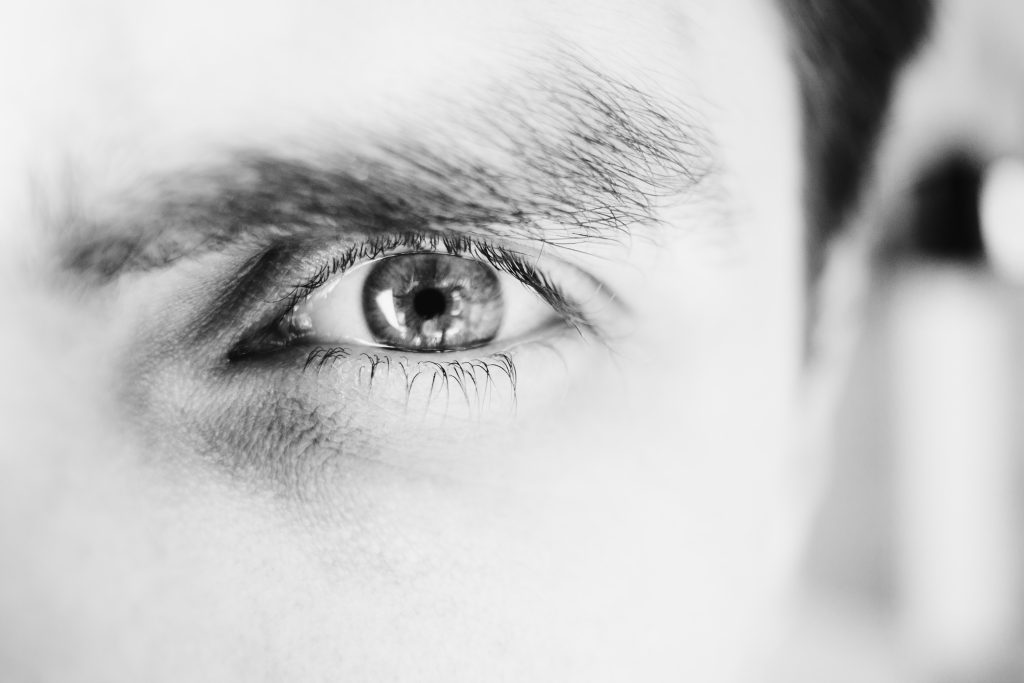 Single male eye in black and white - free stock photo