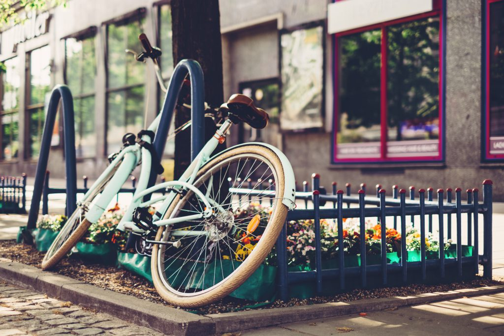 Vintage bicycle leaning against a bike rack 3 - free stock photo