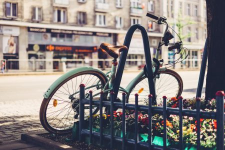 Vintage bicycle leaning against a bike rack 2 - free stock photo