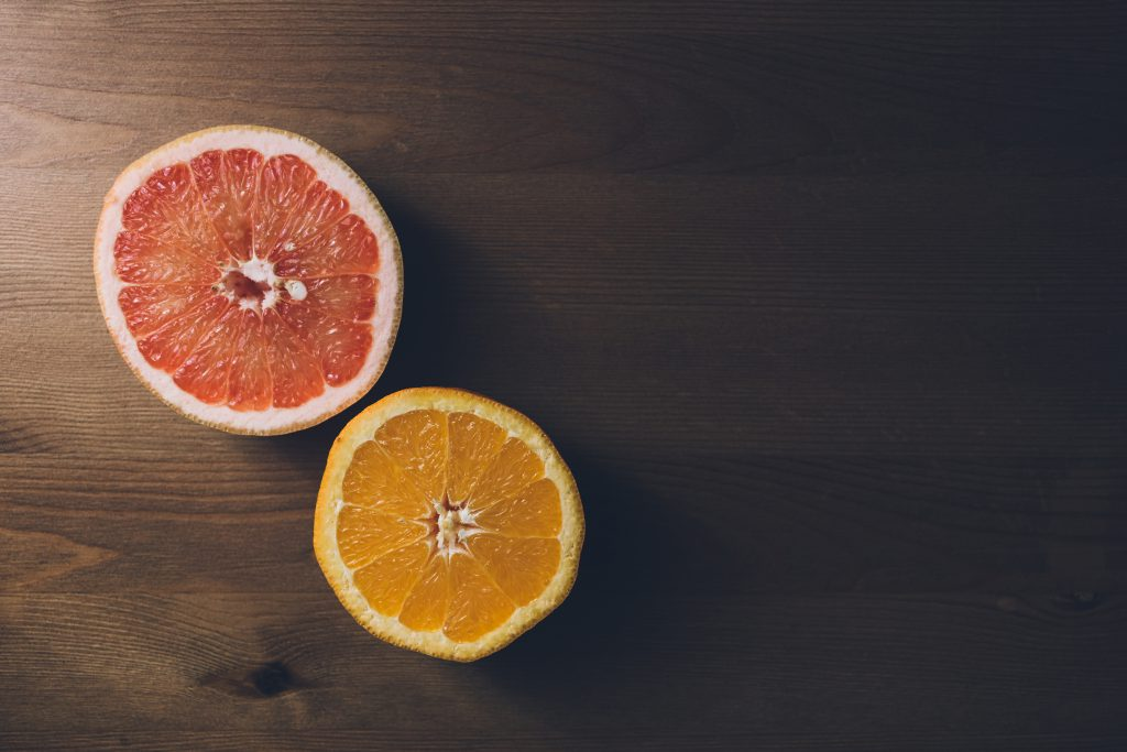 Grapefruit and orange cut in half 2 - free stock photo