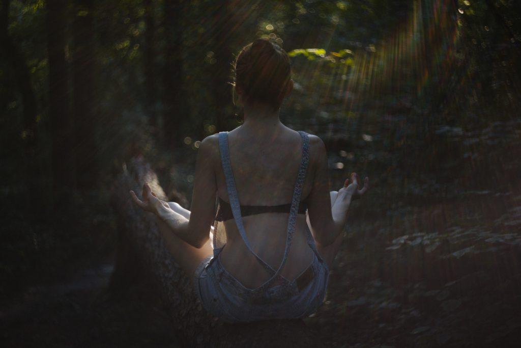 Helios shot of a girl meditating - free stock photo