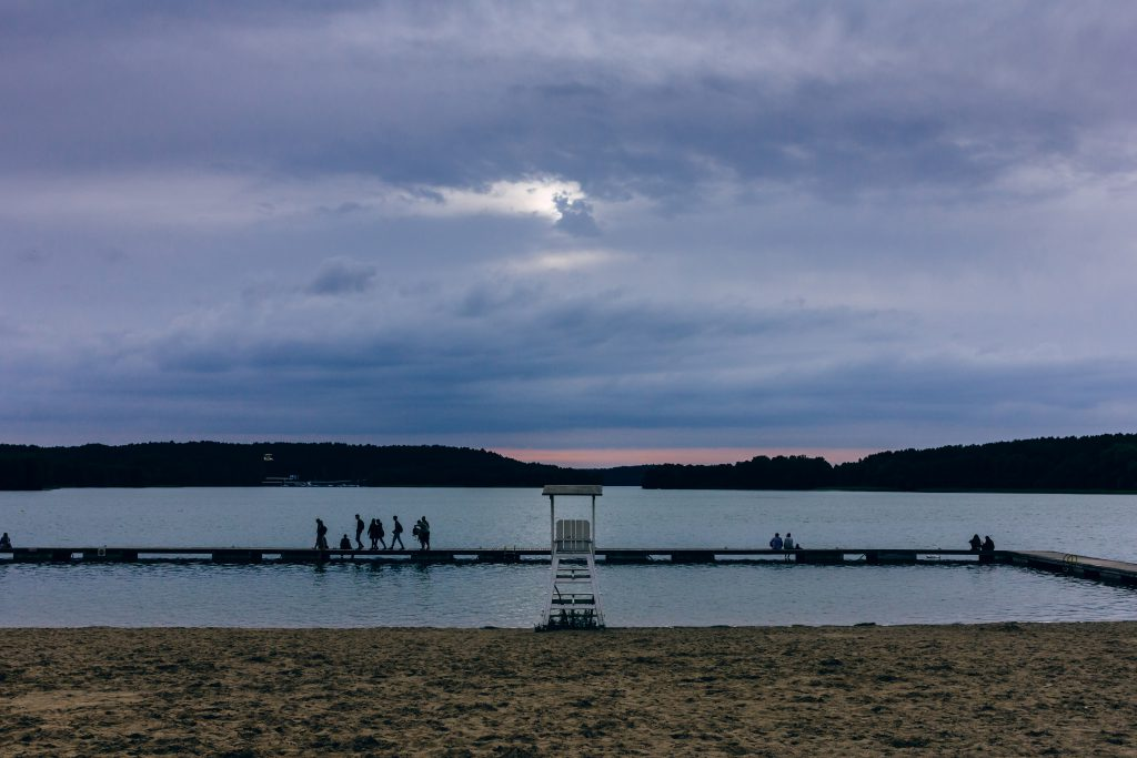 People standing on the pier at dusk - free stock photo
