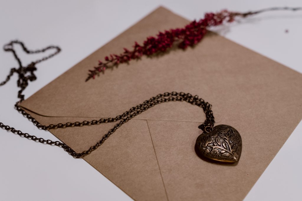 Heart necklace on a craft envelope - free stock photo