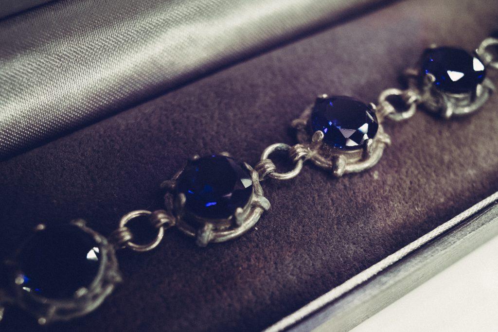 Silver bracelet with blue gems closeup - free stock photo