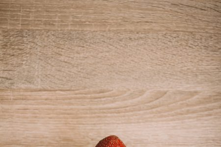 Strawberry in a male hand 2 - free stock photo