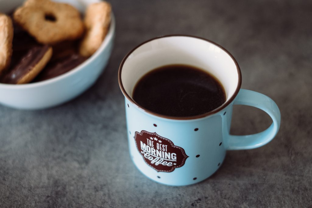Black coffee and biscuits - free stock photo