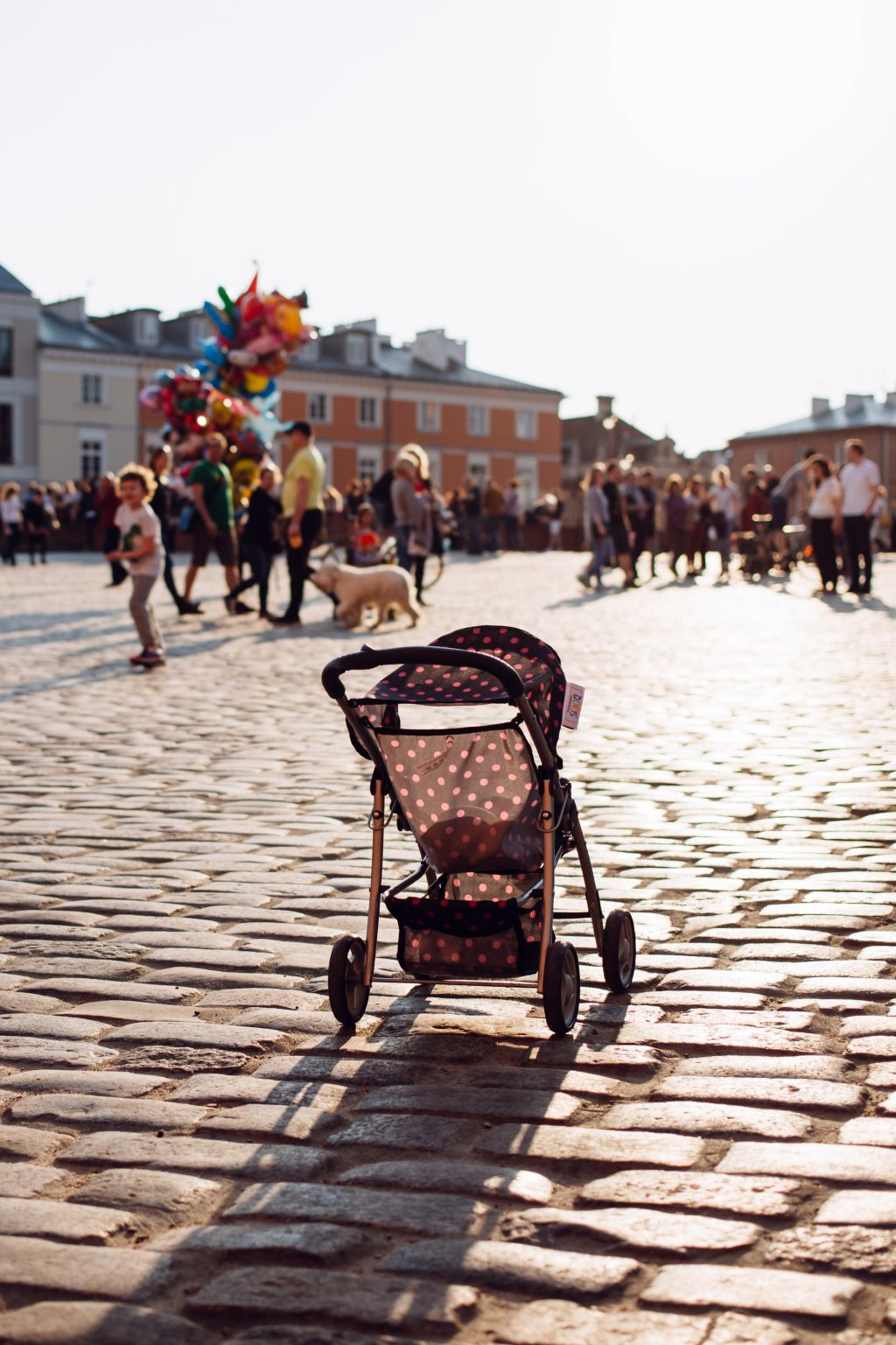 Empty stroller in a crowded Old Town square 2 - free stock photo