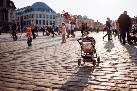 An empty stroller in a crowded Old Town square 3 - free stock photo