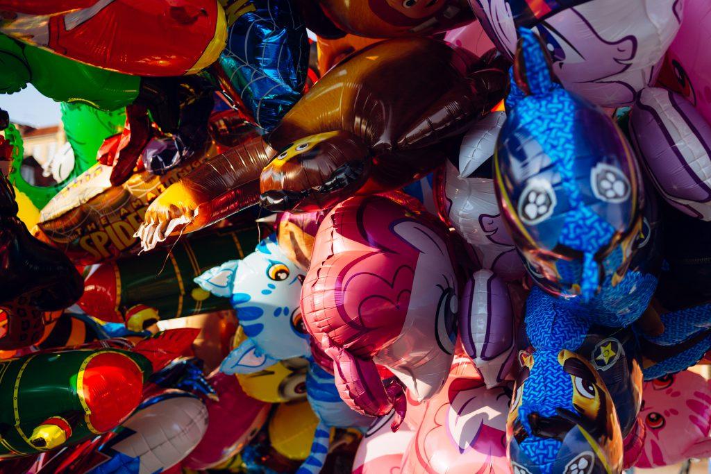 Helium cartoon balloons closeup - free stock photo