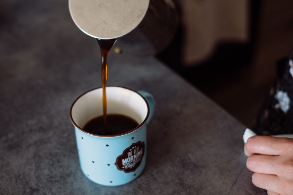 Pouring coffee from a percolator - free stock photo