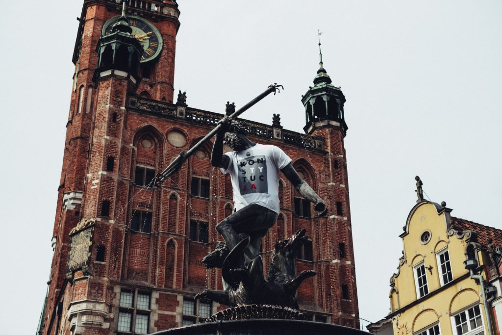 Statue of Neptune in a T-shirt - free stock photo