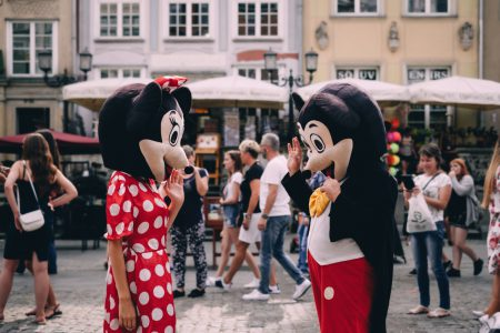 Mickey and Minnie waving at tourists 2 - free stock photo