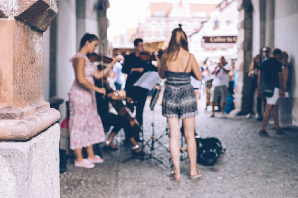 People playing classical music in the old town - free stock photo
