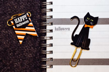 A black cat and Happy Halloween paperclips - free stock photo
