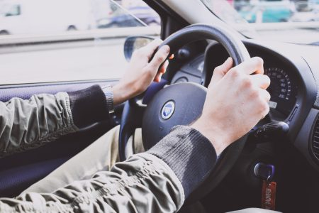 Male hands on a car steering wheel - free stock photo