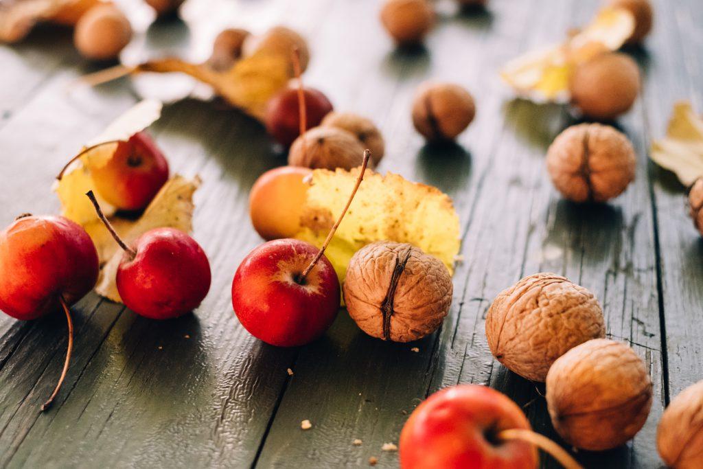 Mini apples and walnuts - free stock photo