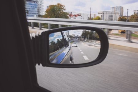 Reflection in a car side mirror - free stock photo