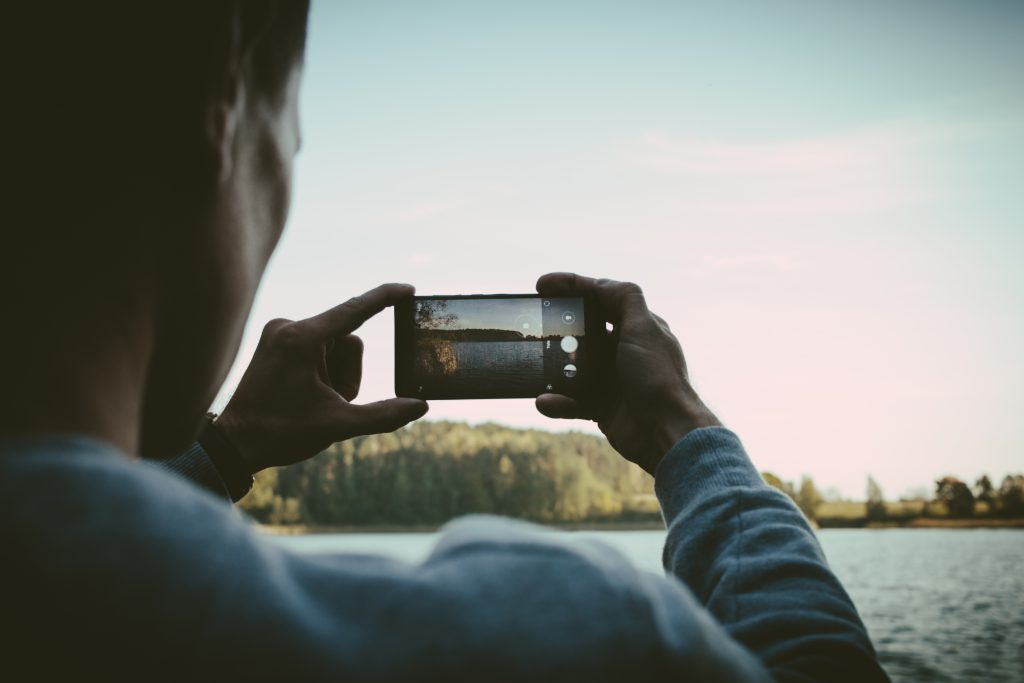 Man taking a picture with his cellphone - free stock photo