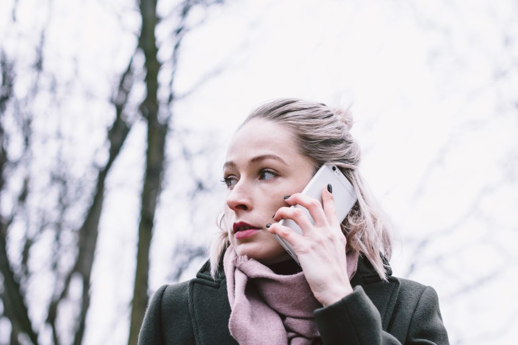 Young woman talking on the phone outdoors - free stock photo